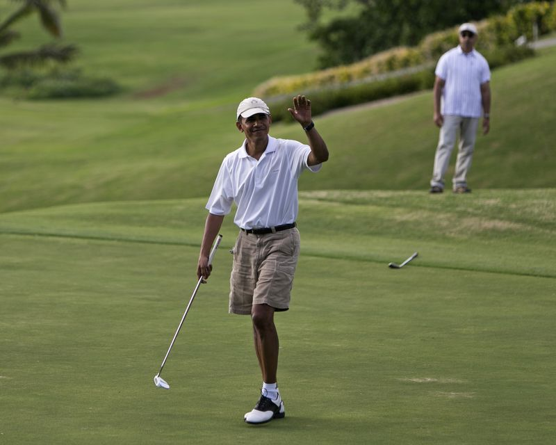 President  Barack Obama  waves to the gallery watching him play on the 18th green at the  Mid Pacific Country Club  , Wednesday, .Jan. 1, 2014 in Lanikai on the island of Oahu, in Hawaii. (AP Photo/  Marco Garcia  )