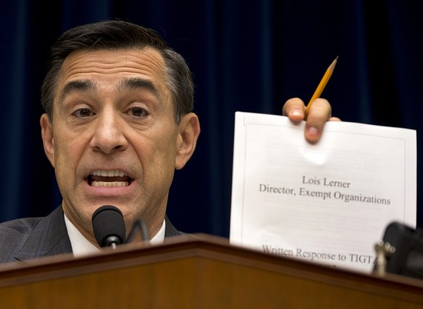 House Oversight Committee Chairman Rep. Darrell Issa, R-Calif. holds up a document as he speaks to IRS official Lois Lerner on Capitol Hill in Washington, Wednesday, May 22, 2013, during the committee's hearing to investigate the extra scrutiny IRS gave to Tea Party and other conservative groups that applied for tax-exempt status. Lerner told the committee she did nothing wrong and then invoked her constitutional right to not answer lawmakers' questions. Credit: AP