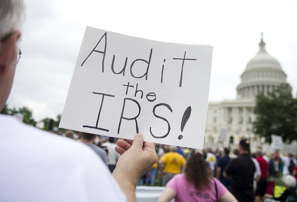 Demonstrators with the Tea Party protest the Internal Revenue Service (IRS) targeting of the Tea Party and similar groups during a rally called 'Audit the IRS' outside the US Capitol in Washington, DC, June 19, 2013. Credit: AFP/Getty Images