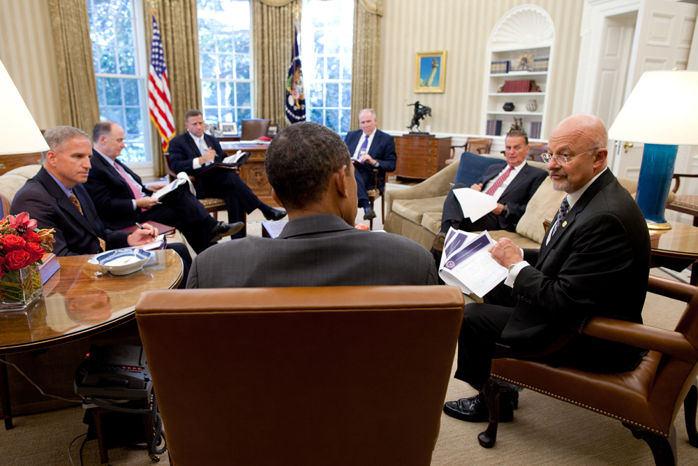 President Barack Obama meets with Director of National Intelligence James Clapper, right, in the Oval Office, Sept. 9, 2010. Also attending are, clockwise from left, Robert Cardillo, DIA Deputy Director, Deputy National Security Advisor Tom Donilon,  Rodney Snyder, Senior Director for Intelligence Program, NSS, John Brennan, Assistant to the President for Homeland Security and Counterterrorism, and National Security Advisor Gen. James L. Jones. (Official White House Photo by Pete Souza)