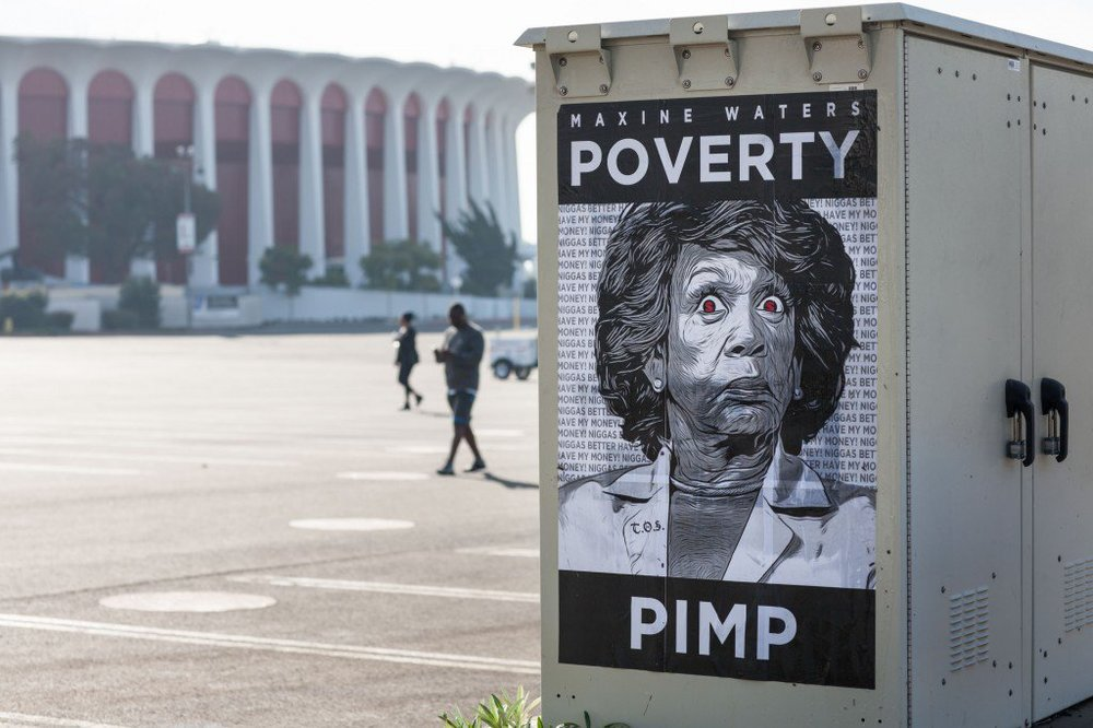 Maxine-Waters-Poverty-Pimp-Poster-in-front-of-the-Fabulous-Forum-1024x682.jpg