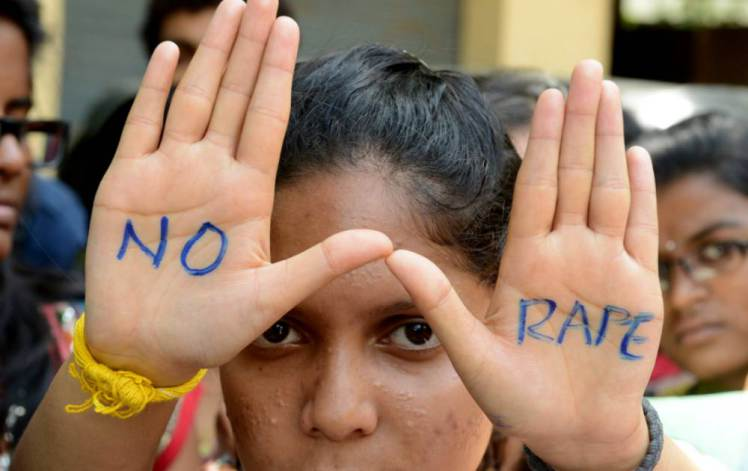 Indian students of Saint Joseph Degree college participate in an anti-rape protest in Hyderabad on September 13, 2013.   The judge hearing the case of four men convicted for a shocking gang rape on a bus in New Delhi in December 2012 sentenced them to death. AFP PHOTO / Noah SEELAM        (Photo credit should read NOAH SEELAM/AFP/Getty Images)