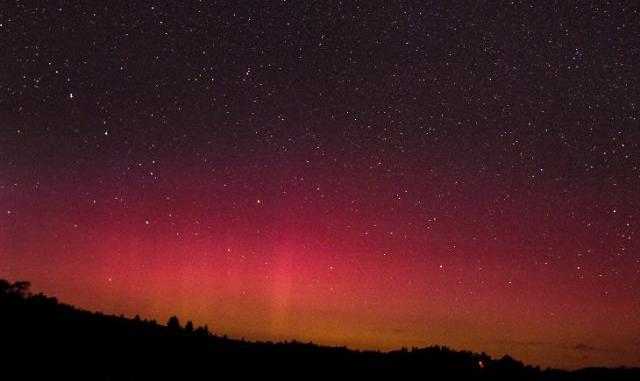Blood red auroras in the sky of Spruce Knob, West Virginia.  Credit: Photo by  Darren Shank .