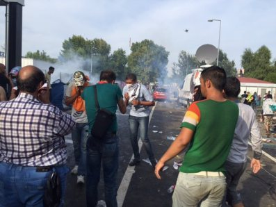 """Hungarian police say they responded with tear gas and water cannon when a group of """"aggressive"""" migrants broke through a border gate from Serbia on September 16, 2015"""