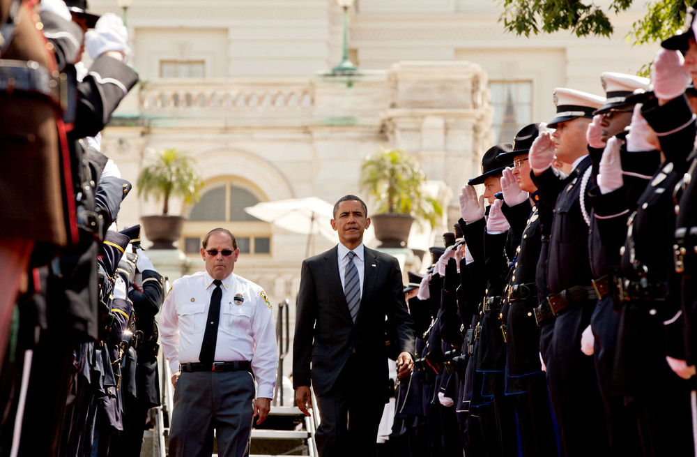 President Barack Obama, with Chuck Canterbury, president, Grand Lodge Fraternal Order of Police, arrives at the National Peace Officers Memorial Service, an annual ceremony honoring law enforcement officers killed in the line of duty in the previous year, at the U.S. Capitol in Washington, D.C. May 15, 2012.  (Official White House Photo by Pete Souza)