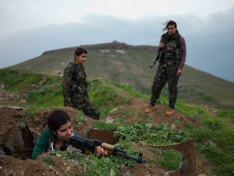 YPJ fighters on their base at the border between Syria and Iraq. Young female fighters are indoctrinated to the ideology of their charismatic leader, Abdullah Ocalan, head of the Kurdish Workers' Party (PKK), who promotes marxist thought and empowerment of women.