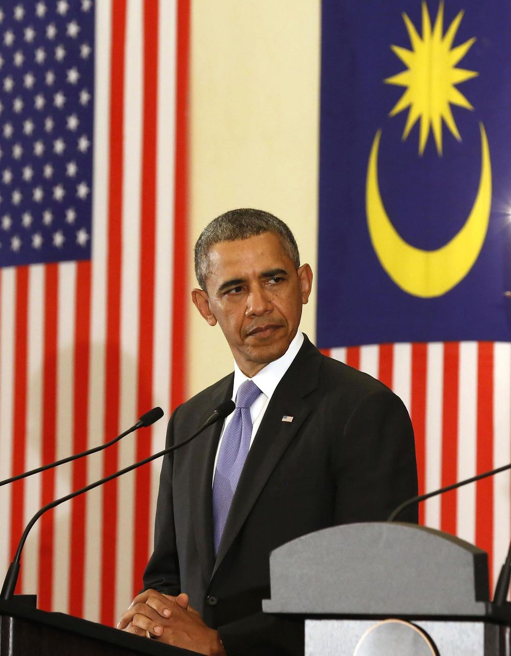 ABOVE: With the Islamic-influenced Malaysian flag as a backdrop, Barack Obama publicly lashed out at any and all who have criticized his response to ISIS and his oddly driven desire to allow thousands of Syrian refugees into the United States. Mr. Obama went so far as compare those who oppose his policies to terrorists.