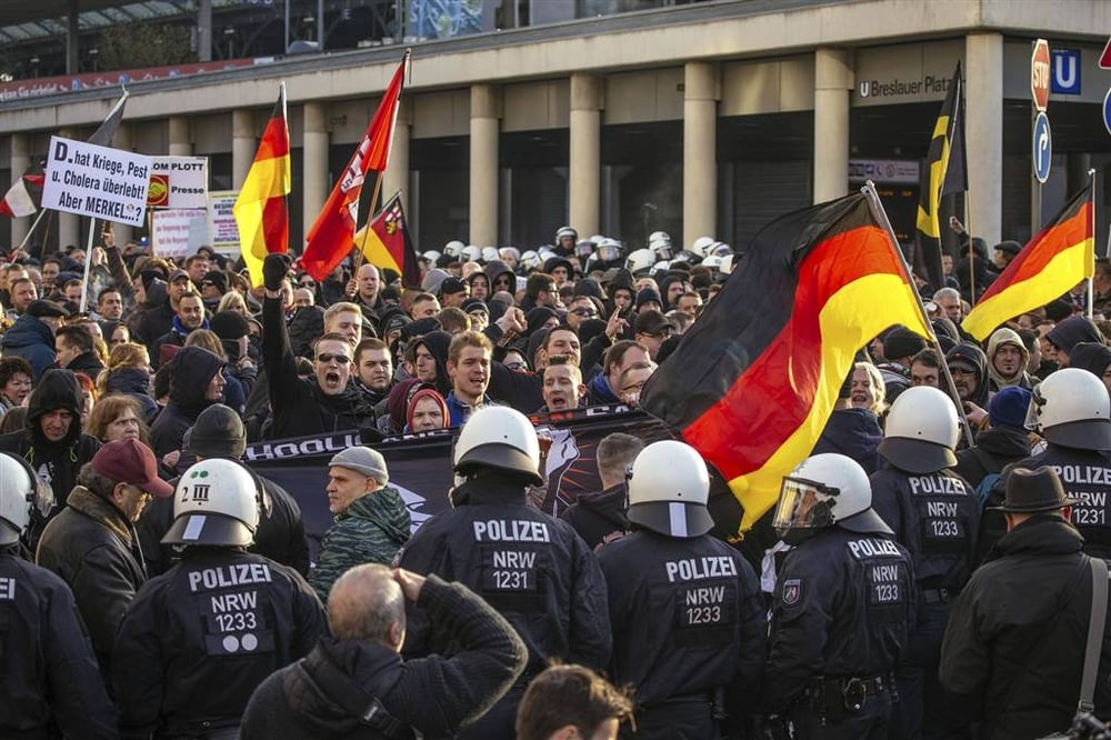Police confront supporters of the anti-immigration right-wing movement PEGIDA (or Patriotic Europeans Against the Islamisation of the West) during a march in Cologne, Germany, on Jan. 9.