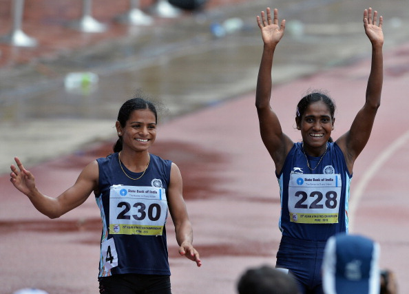 Indian runner Dutee Chand, left, was suspended by the IAAF in 2014 for hyperandrogenism and missed the Commonwealth games and Asian games as a result. (Manjunath Kiran/AFP/Getty Images)