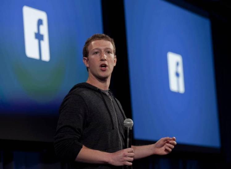 epa04901363 (FILE) A file picture dated 04 April 2013 shows Facebook co-founder and CEO Mark Zuckerberg speaking during an event at the Facebook headquarters in Menlo Park, California, USA. More than one billion people logged into the social media network Facebook in one day, marking a new record for the company, said Facebook co-founder and chief executive Mark Zuckerberg on 27 August 2015. The 31-year-old entrepreneur said the milestone was the 'beginning of connecting the whole world,' according to a message on his Facebook site.  EPA/PETER DaSILVA