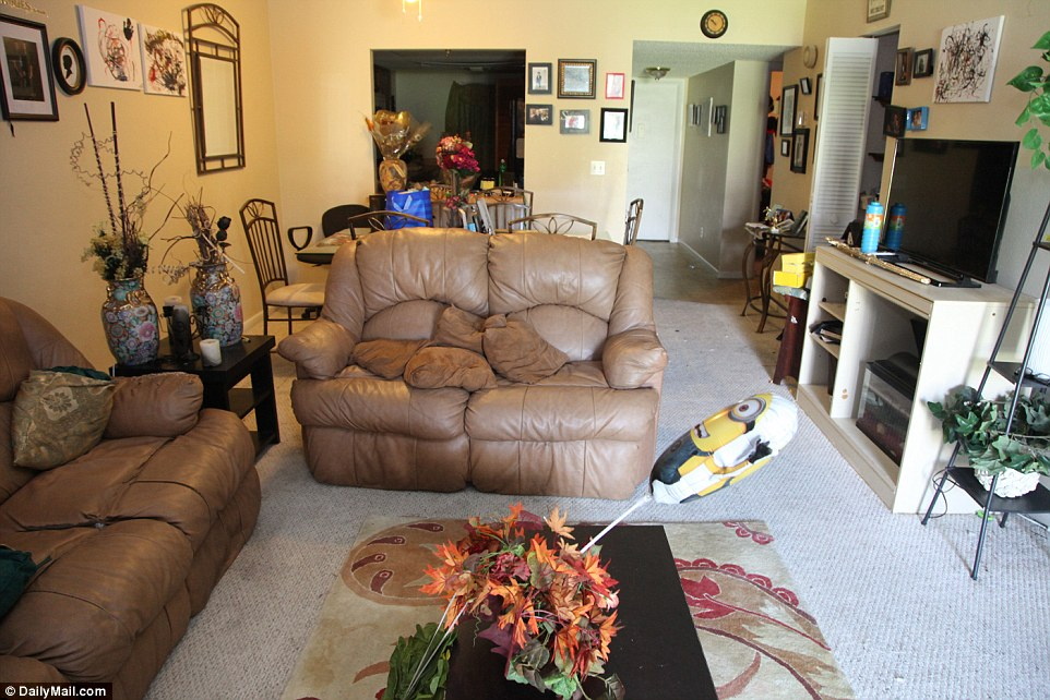 353BF67C00000578-3639587-The_shooter_s_living_room_looks_normal_and_untouched_but_investi-a-2_1465843592164.jpg