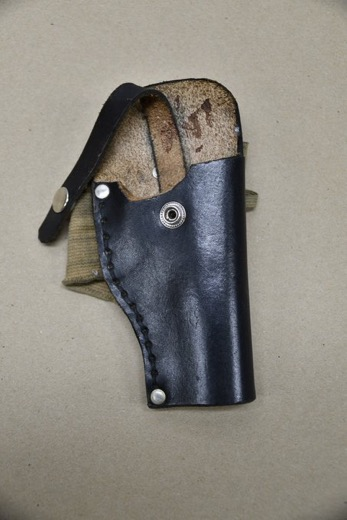 His ankle holster
