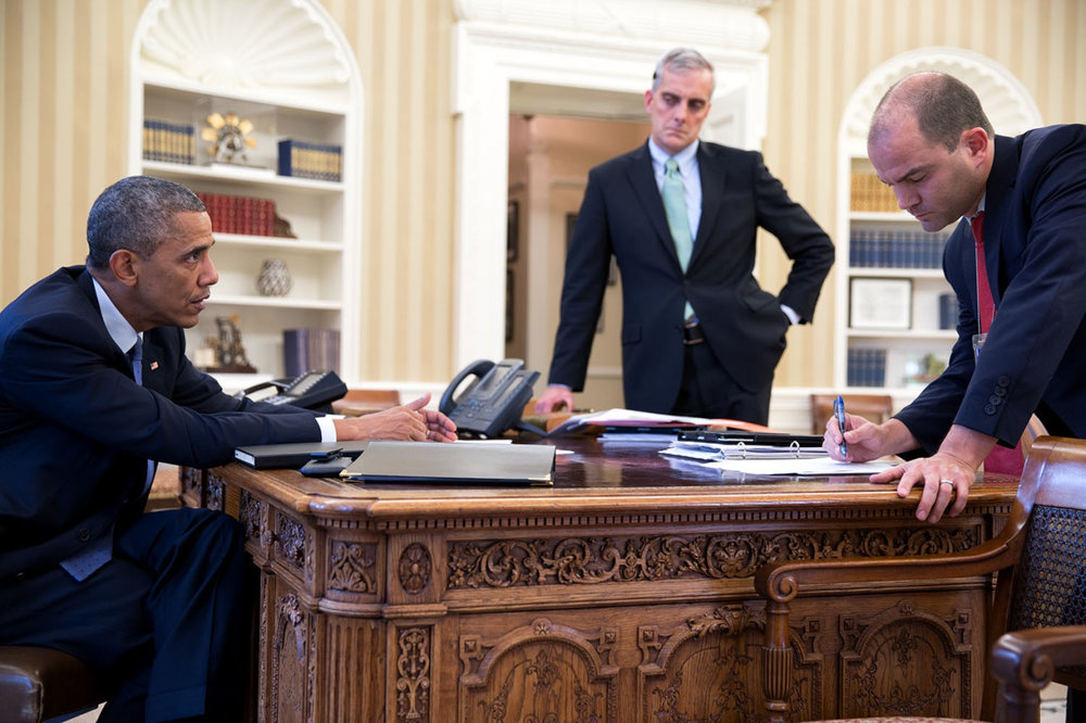 President Barack Obama meets with Chief of Staff Denis McDonough and Ben Rhodes, Deputy National Security Advisor for Strategic Communications, right, in the Oval Office, Aug. 7, 2014. (Official White House Photo by Pete Souza)This official White House photograph is being made available only for publication by news organizations and/or for personal use printing by the subject(s) of the photograph. The photograph may not be manipulated in any way and may not be used in commercial or political materials, advertisements, emails, products, promotions that in any way suggests approval or endorsement of the President, the First Family, or the White House.