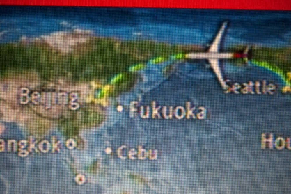 The monitor from the inside of the plane showing our progress towards Beijing.