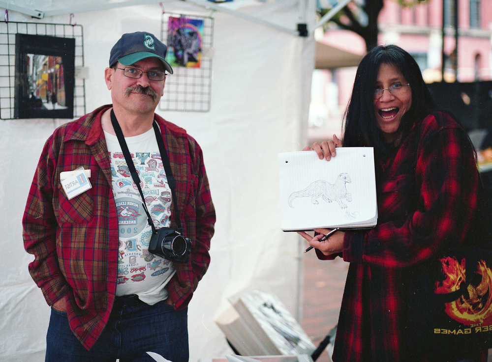 Jim and Deborah posing with the newly minted sketch. Image captured on Mamiya 645 AFD II with Kodak Portra 400.
