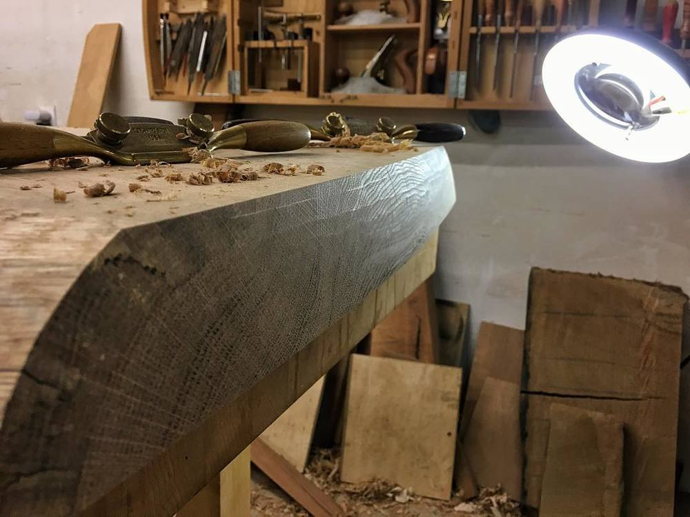 Shaping one of the ends of the seat. I'm excited to finally be finished cutting the joinery for the bench, which ended up being fussier than I had expected, and moving on to shaping parts by hand and eye with planes and spokeshaves. It's getting there! #letsmakeabench #whiteoak