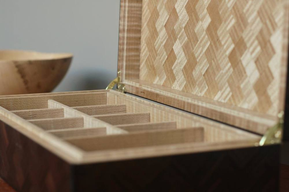 Detail of the interior- curly maple partitions for watches/accoutrements, maple herringbone on the inside of the lid and bottom of the box. #letsmakeawatchbox #madeinhouston