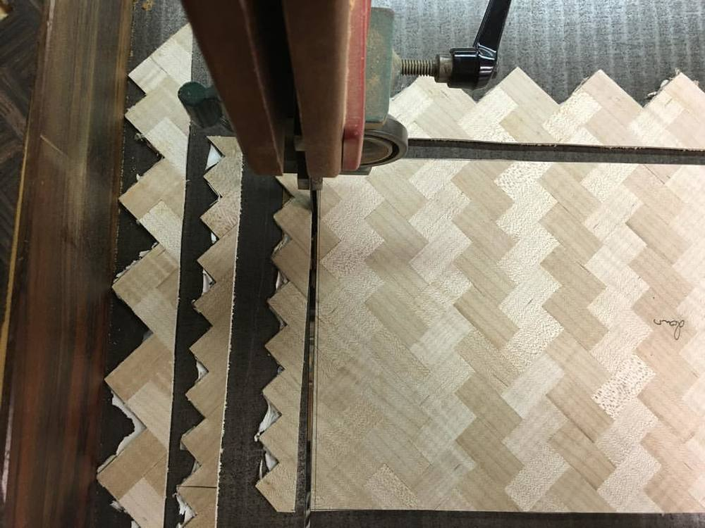 Trimming the built-up veneer sheets to size, then it's off to the vacuum bag. #letsmakeawatchbox