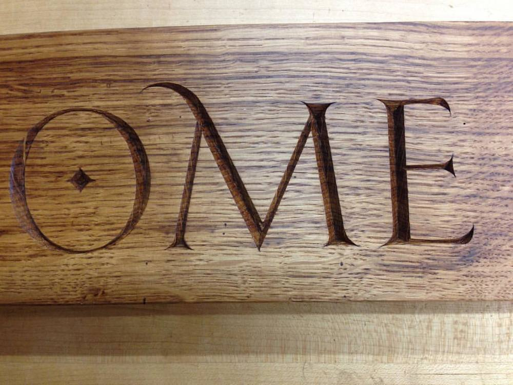 Fancy detail from the welcome sign! #ome #swash #lettercarving
