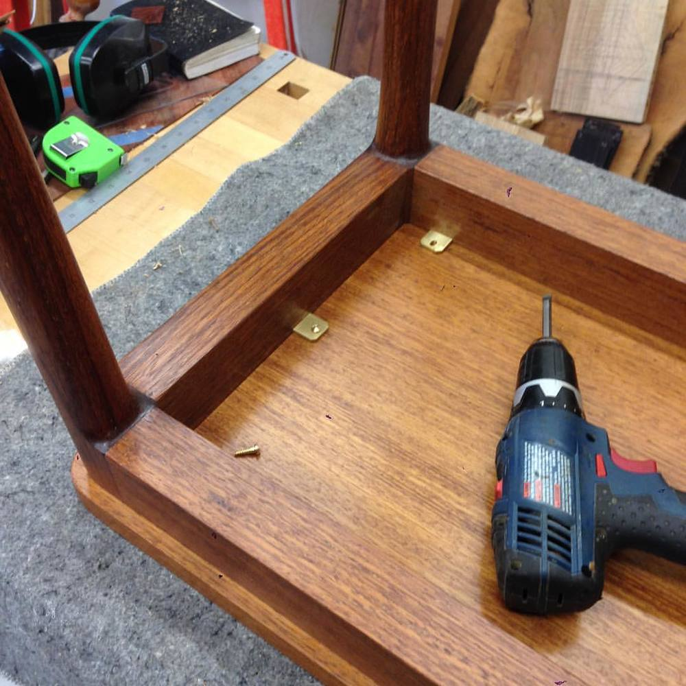 Finishing touches on the kwila console table…