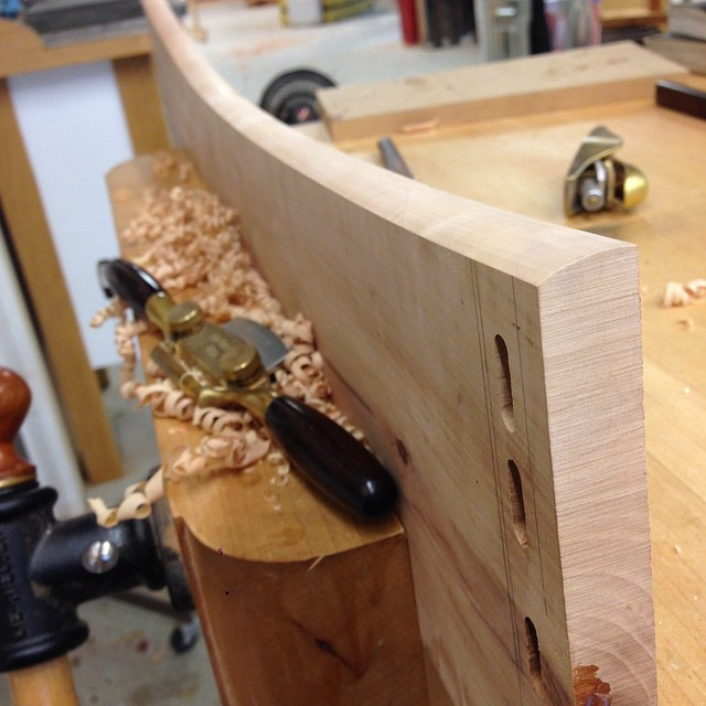 Spokeshaving* a profile into the front edge of one of the cabinet parts. #fshome