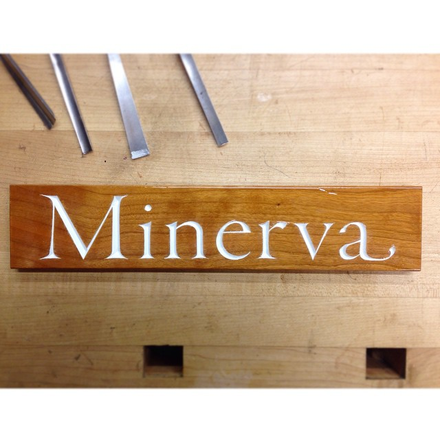 """…and done! """"Minerva"""" nameplate, Garamond typeface, varnished and painted cherry. #minerva #lettercarving"""