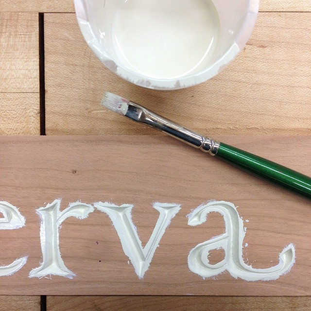 First coat of off-white polyurethane. #lettercarving #minerva