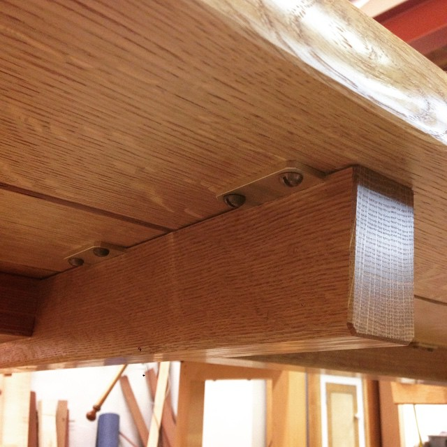 Underside detail of the top plank-batten connection. The plates mount flush with the top of the base, then the top is attached with roundhead screws. On a normal top, the screw holes would be slotted to allow for wood movement, but because the top of this table is made of individual planks, movement isn't really an issue. #diningdiscourse