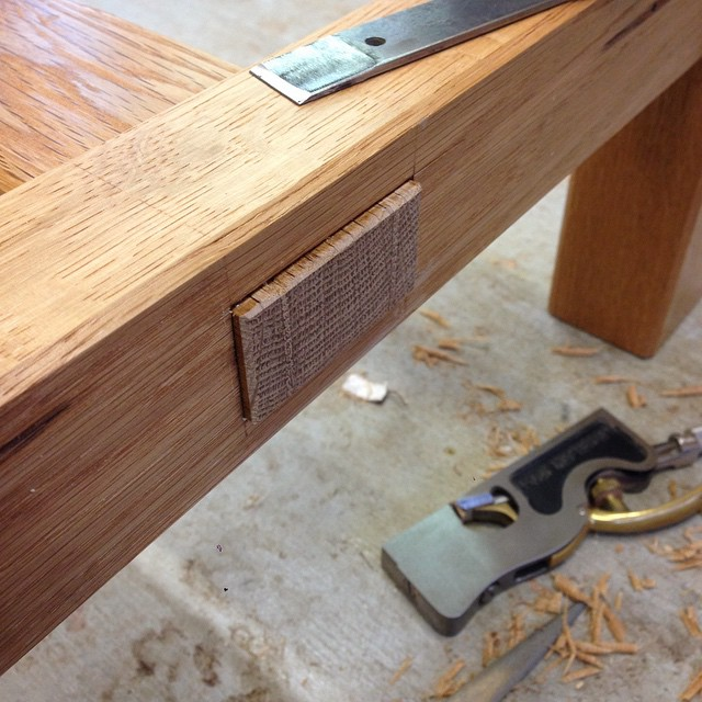 Detailing one of the wedged through-tenons, trying not to wreck the finish. #diningdiscourse