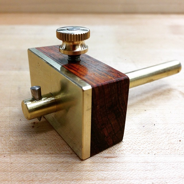 Heck yeah. Adjustable brass and cocobolo scribing gauge, which I will use for laying out measurements on brass when I am making hardware. The actual scribing-point is the tip from an old etching needle from printmaking days. I am really excited about this- this little thing has been rattling around in my head for years. Making your own tools is the best. #makingthethingthatmakesthething
