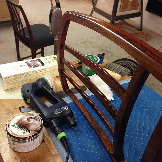 "Fancy chair polishing. Cocobolo's a weird one: it seems to kind of shrug off oil like it's got something better to do (""Really, you're gonna make me wear *this*?""), but man it looks like a million bucks once it's waxed and polished. #sofancy"