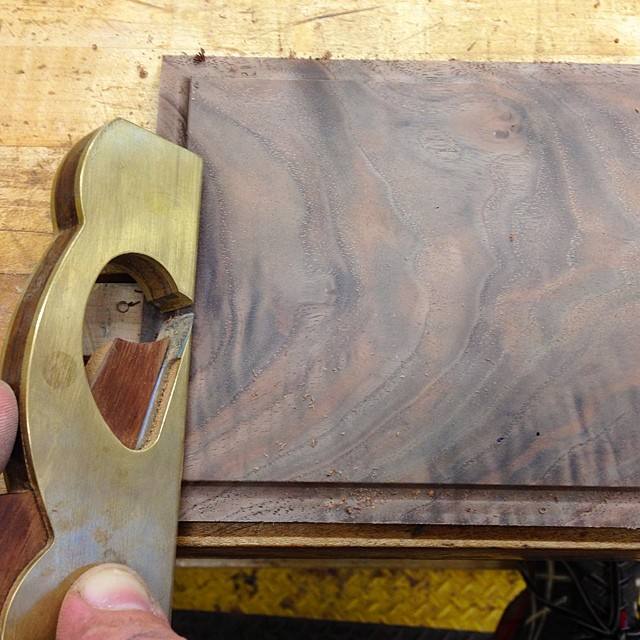 Softening the edges of one of the raised back panels with a modified shoulder plane. #letsmakeadresser #lienielsen