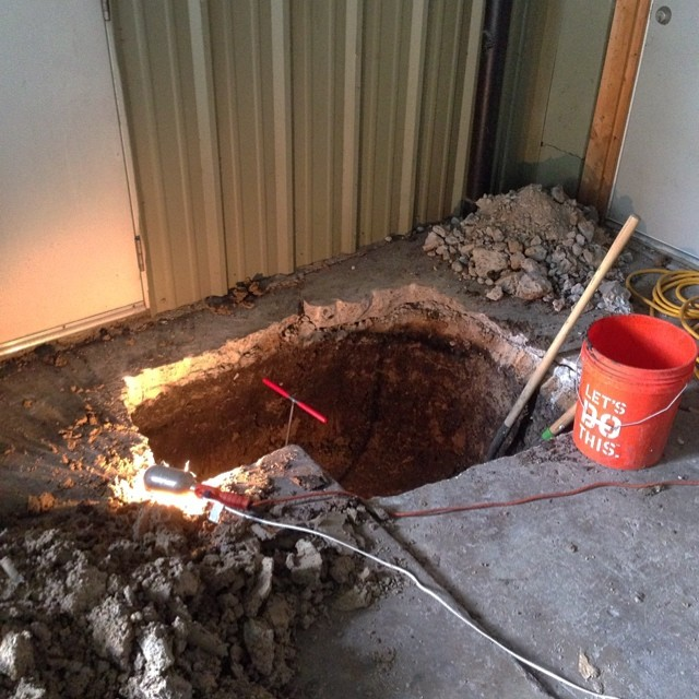 Got back to the shop after lunch to this: ostensibly a pit dug in search of a missing sewage pipe, but more likely a hole to China. Possibly an exploratory oil well. Difficult to say for sure. Bonus: the toilet in the shop has been helpfully relocated to the middle of the shop. When I walked inside the plumber was sitting on (but not, fortunately, using) the toilet in question, watching Youtube videos on his phone. Good times. Good times. #bucees #fabulousrestrooms #breaktime #canigohomenow