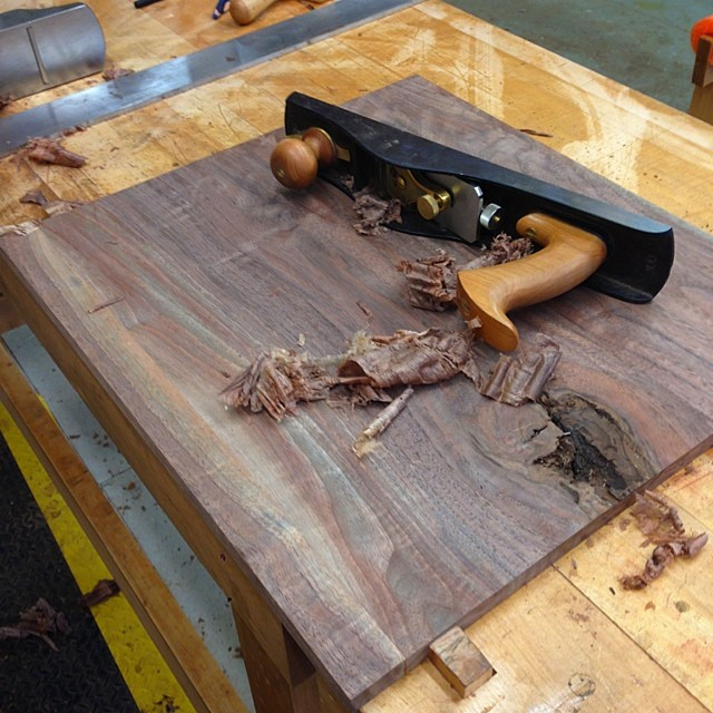 "Planing the extra-wide walnut panels from yesterday. Just for the record, there's no sweat-fueled moral high ground here; if I had an 18"" planer in the shop, I would send these things through it in a heartbeat. #electricity #machines #handtools #letsmakeadresser"