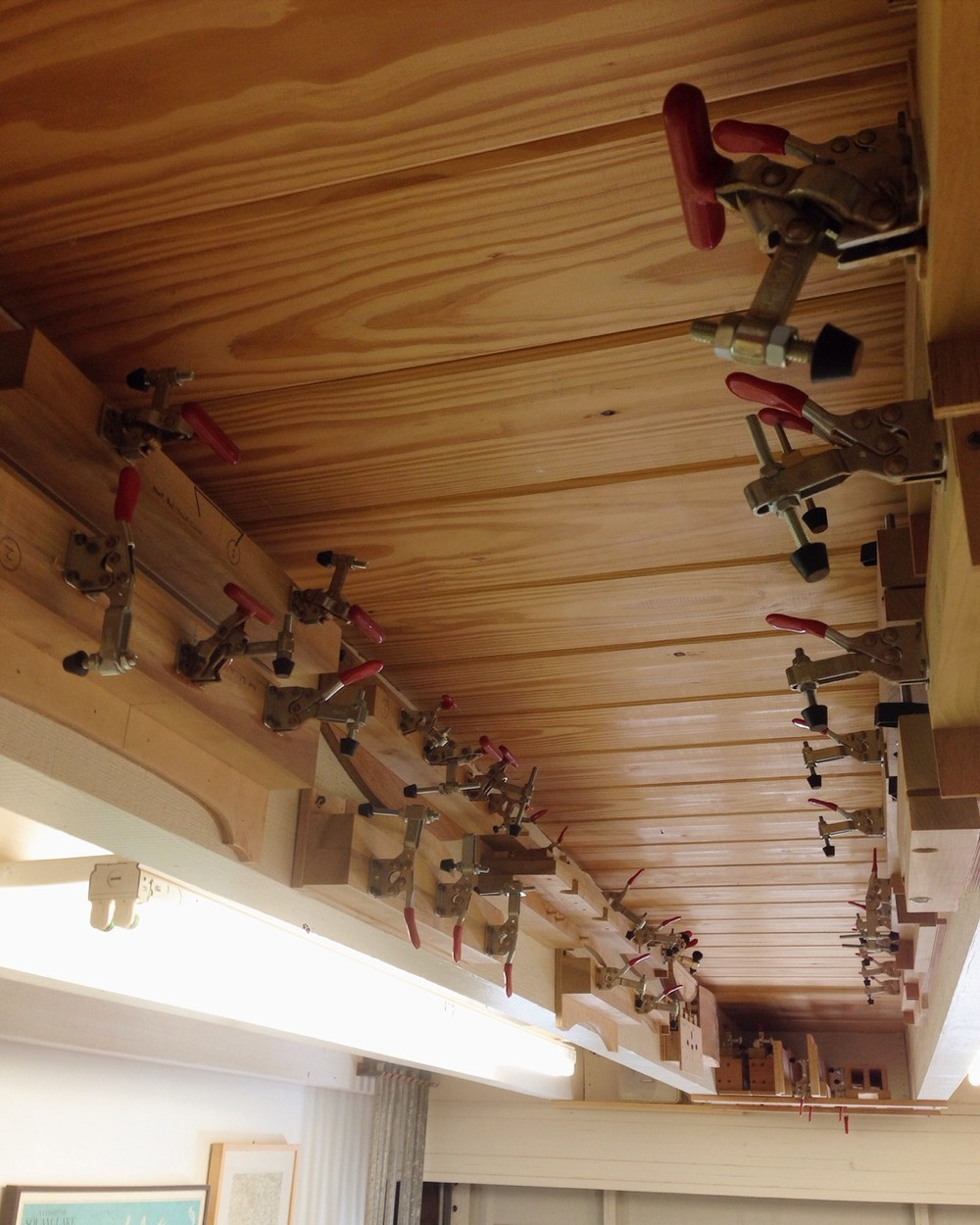 Finally got all of the game chair-making jigs hung up on one of the shop ceiling beams.