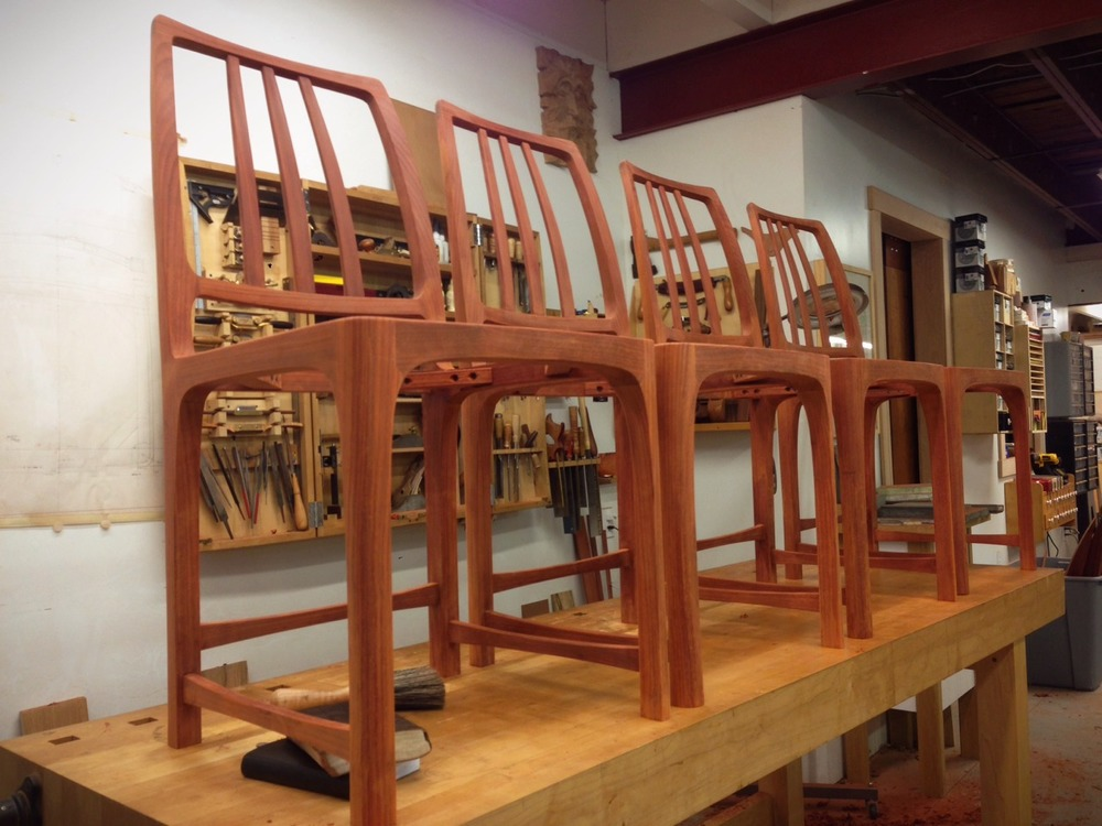Padauk game chairs, joined, shaped, sanded, detailed, and ready for finish.
