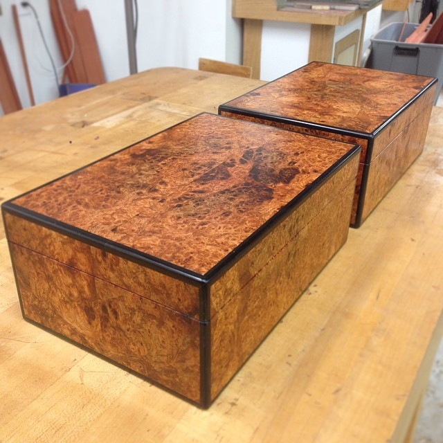 Double top secret from the last two-something weeks. A pair of music boxes: Four-way book matched amboyna burl, ebony, satinwood, and narra. Excited with how they turned out. Equally excited to be finished with them. It has has been a long couple of weeks.