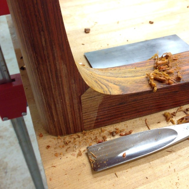 Carving the sweep under one of the chair legs. Excited to be back in the shop.