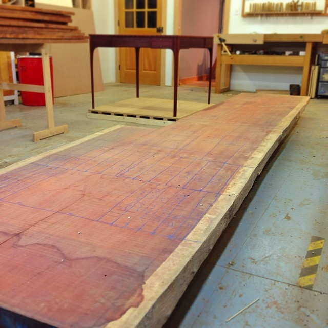 So excited to finally wheel this out of deep storage: a 14'x4'x10/4 slab of padauk, which will shortly get broken down into a whole mess of chair parts. The other slab from this flitch got turned into the bridge table (off in the background there), and a a sizable chunk from this piece was used to make veneers for the tabletop. All together, I have just about exactly enough wood to make four chairs to go with the table. #workmanshipofrisk #dontjinxit