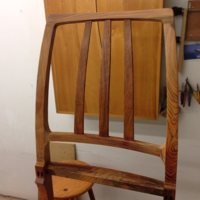 Shaped and detailed chair back. Two down, one to go.