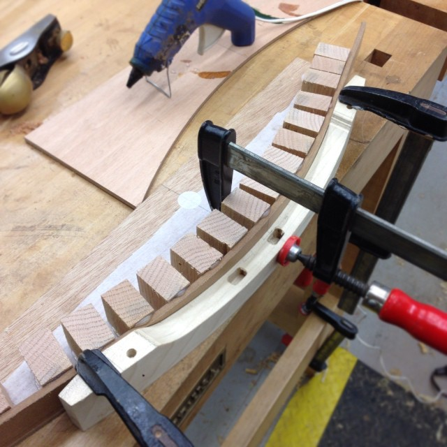 Hot-gluing a form to get an exact negative of the curve of the crest rail.