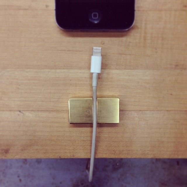 I am considering doing a run of these little brass cord-minders. I think they are pretty cool- they keep your phone charger cord from doing what it is apparently programmed to do, which is fall off of whatever surface you have it sitting on.     Would anyone out there in the Ether be interested in one if I offered them for sale? #gravitywoes