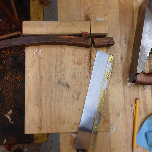 Cutting one of the laminated lumbar rails to rough length.