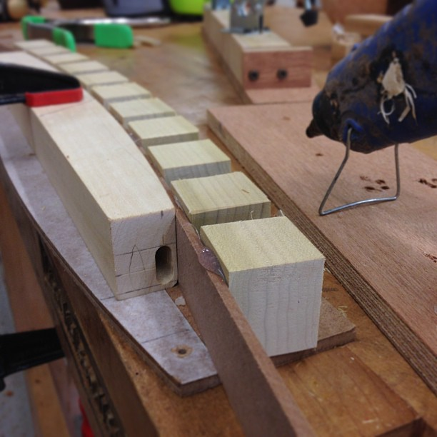 Hot-gluing a reverse/mating pattern to match the curve of the back rail.