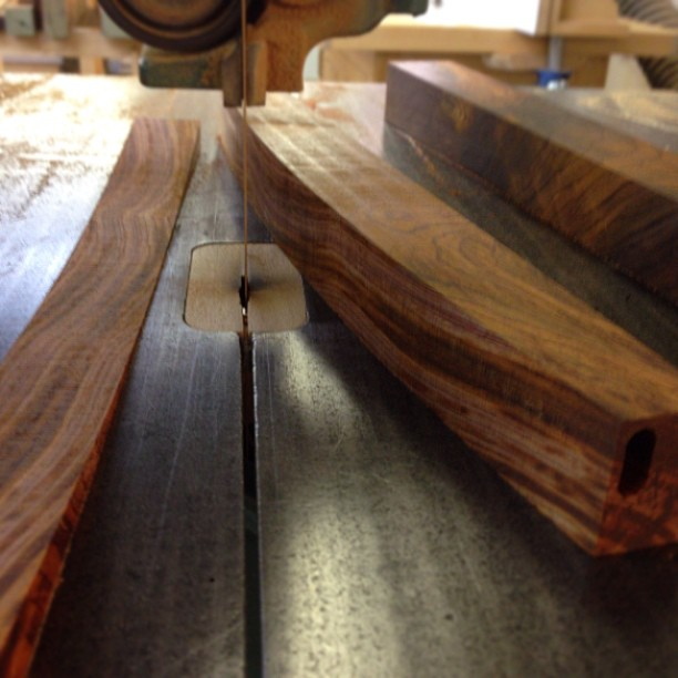 Sawing one of the back rails to shape.