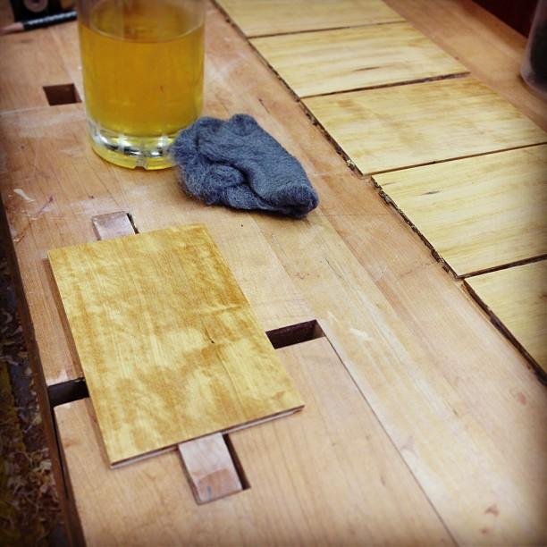 Shellacking and polishing satinwood panels before glueup.