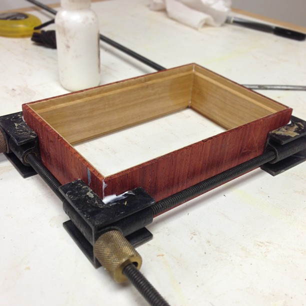 One of four veneered and mitered boxes, glued and clamped.