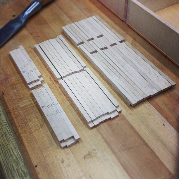 80 tiny half-lapped sticks, ready to be glued up into drawer dividers.