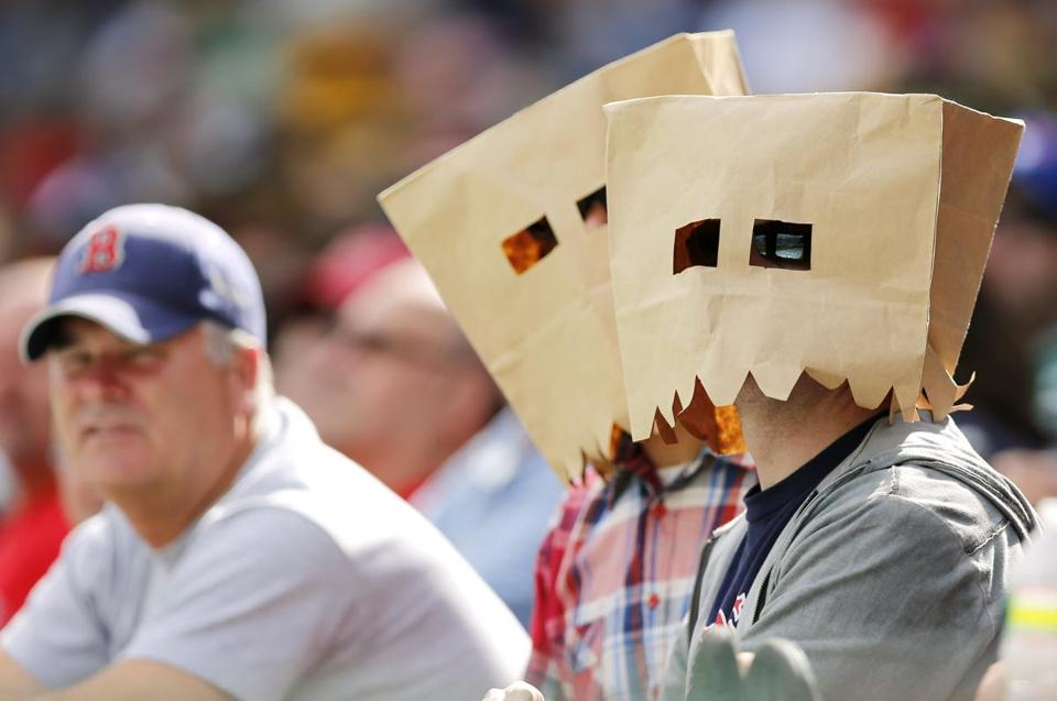Brown bags over heads at Fenway is becoming the norm, as opposed to Sweet Caroline