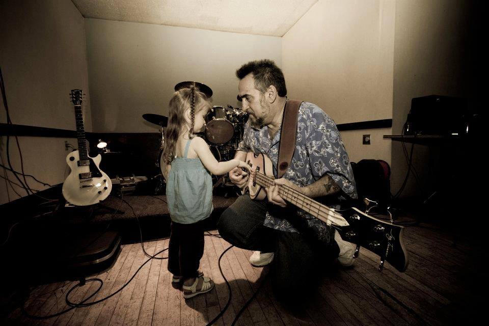One of my favorite pictures of my Dad, playing his bass guitar while my oldest daughter strums along with him.